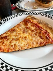 A slice of cheese from the new PrimaFila Pizza in Fort