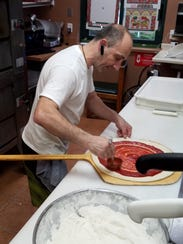 Chef Frank Laudonio works on a pizza at Lombardi's.