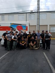 Members of the Fort Myers Police Department pose after