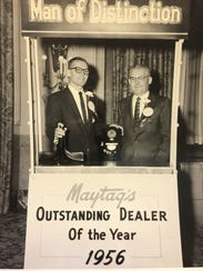 Frank and Joe Butz accept the 1956 Maytag dealer of