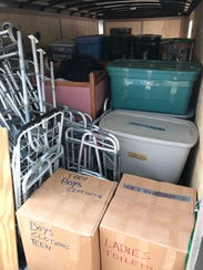 A 20-foot trailer is packed with donated items bound