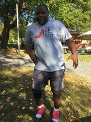 Ray Williams gets ready to race in high heels for the