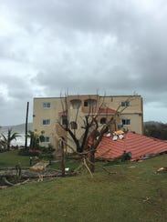 The roof was torn off the Fiorettis' room by Hurricane
