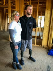 Taylor and Danielle Morris at their home under construction