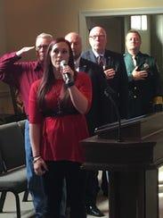 Lauren Tisdale sings the National Anthem during Robertson