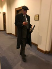 Charles Szyman exits the courtroom after the third