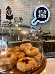 Fresh, house-baked pastries line the counters at Artisan
