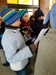 Horace Mann Middle School students ring bells and sing
