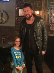Loren Patterson, 7, poses with Christian music artist