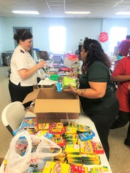 Lt. Laura Gesner prepares to hand out school supplies