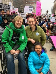 D'Lynn Smith, 53, of Charlotte, Mich., (left) attends