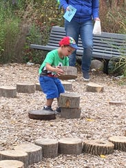 """""""Blocks"""" from a cut-down tree are a great natural toy."""