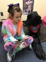 At Webster's Schlegel Elementary School, Payton listens