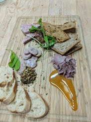 Lento will hold a special Swine and Wine dinner for