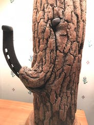 """Edgar Faust's """"horseshoe tree"""" lamp dating to the 1930s."""