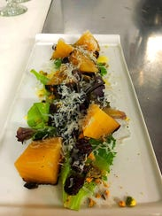 A Golden Beet Salad is prepared with dried cherries, pistachios, honey vinaigrette and ricotta salata at C.C.'s Kitchen in Haddon Heights.