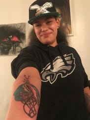 Desiree Pulliam shows off her fresh Eagles' tattoo.