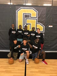 The Golden Gate Unified Champion School boys basketball team takes on Immokalee for the state championship Thursday at the Lakeland Center. Front row, left to right: Jesus Carillo, Mike Anderson and Tyquan Johnson. Back row, left to right: Coach Reggie Hamilton, Stanley Massillon, Rubinstein Joseph, Markinson Telusnord, coach Catherine Lau.