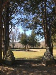 Sculptures in Ringwood Manor's backyard garden sit