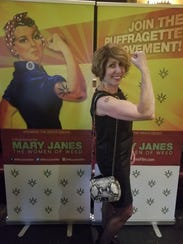 Annabis founder and CEO Jeanine Moss models a handbag