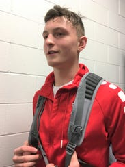Dixie Heights senior Tyler Schreck talks after the