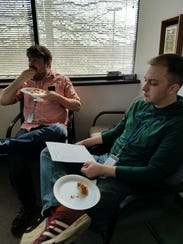 Courier staffers Noah Stubbs, left, and Kyle Sokeland,