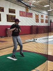 Max Gabrielly pitches inside the cage at Arlington