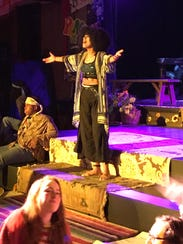 "Thabitha Moruthane performs on stage in ""Hair."""