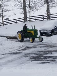 Dad plowing our Driveway with an A-Frame.