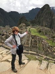 The author, Rebecca Davidson, stands in front of Machu
