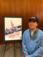 Joe Dao of Lake Orion poses with his winning poster