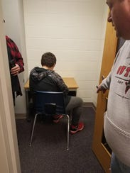 Matthew Schoenecker sits in an isolated cubicle as