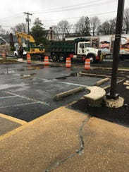 Cones and construction equipment block the entrance