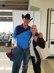 Tim McGinty, who saved Jennifer Riordan from being sucked out of an airplane window, with Peggy Phillips, who administered CPR on Riordan. Riordan died of her injuries.