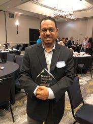 Lead Coach Chris Ramirez won a First Amendment Award