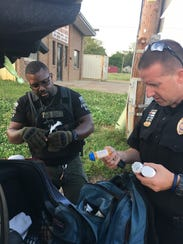 Detective Anthony Fox, left, and Sgt. Barry Hale find drugs in the trunk of a vehicle with a suspicious marijuana smell.