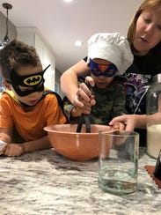 Olivia Burns cooks with her children.