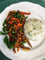 Chicken and Coconut Garlic Rice served with spicy red