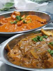 Two popular dishes from Bombay Spice. In the rear,