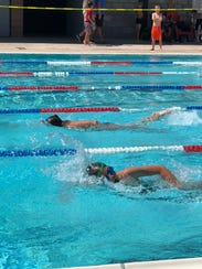 Swimmers compete during the girls 9-10 50-yard freestyle