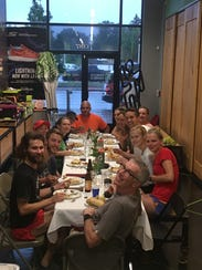 Runners eat a healthy meal at a Run Supper Club dinners.