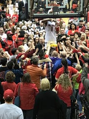 Fans have filled gyms to watch Romeo Langford for several years. He handed out bits of net after New Albany's victory in the Seymour Regional.