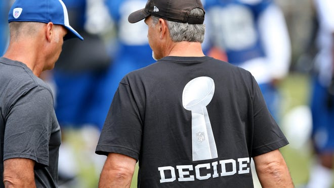 Colts head coach Chuck Pagano wears an inspirational shirt during the first day of training camp at Anderson University.