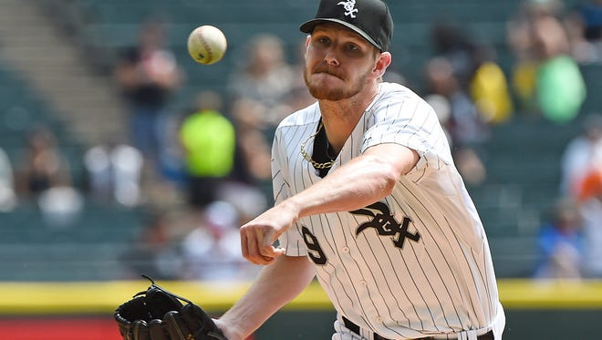 Chicago White Sox starting pitcher Chris Sale throws a pitch against the Detroit Tigers during the first inning at U.S Cellular Field.