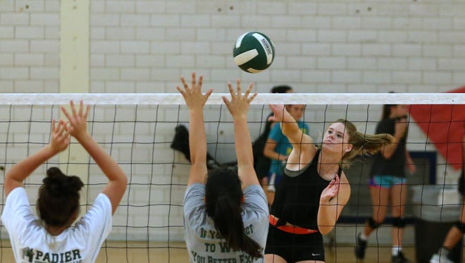 Rockport-Fulton volleyball player Allison Sanders (right) participates in drills at Gregory-Portland High School on Thursday, October 5, 2017.
