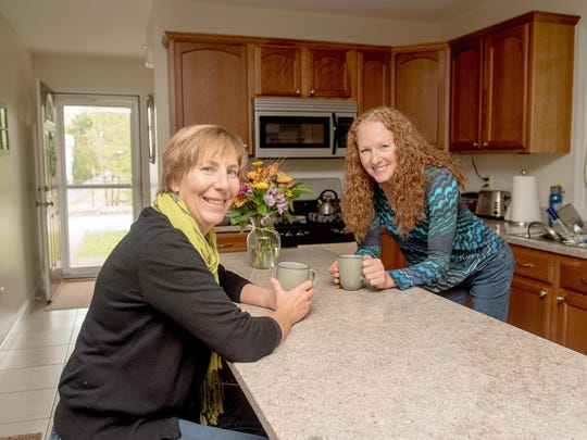 Homesharers since spring of 2016, Susan, left, and Flora share Susan's Colchester townhome.