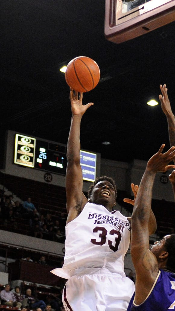 Nov 14, 2014; Starkville, MS, USA; Mississippi State Bulldogs forward Oliver Black (33) shoots over Western Carolina Catamounts guard Mike Brown (2) and forward Kenneth Hall (1) during the game at Humphrey Coliseum. Mandatory Credit: Justin Ford-USA TODAY Sports