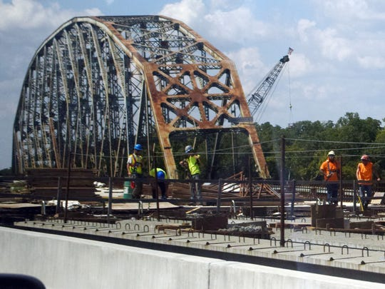 Work is continuing on the southbound span of the Curtis-Coleman Memorial Bridge (foreground) as the  steel superstructure of the O.K. Allen Bridge looms in the background. The O.K. Allen Bridge is scheduled to be demolished Saturday morning. The southbound span is expected to be ready by Jan. 1.