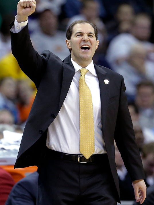 Baylor coach Scott Drew talks to his players during the first half of an NCAA college basketball game against TCU in the Big 12 men's tournament Wednesday, March 12, 2014, in Kansas City, Mo. (AP Photo/Charlie Riedel)