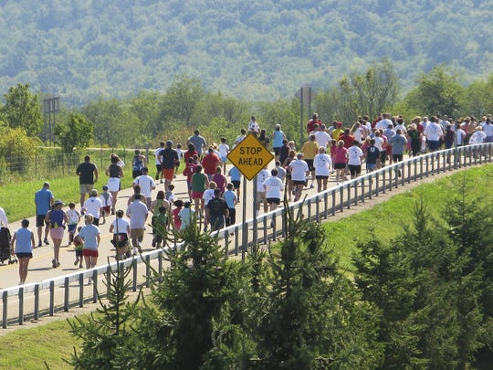 Runners spread out along Lowe Road in Big Flats during